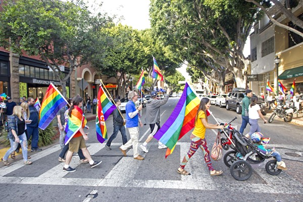 WANTING INCLUSIVITY A group of demonstrators show their pride on Higuera Street in downtown SLO during a rally in 2017. - FILE PHOTO BY JAYSON MELLOM