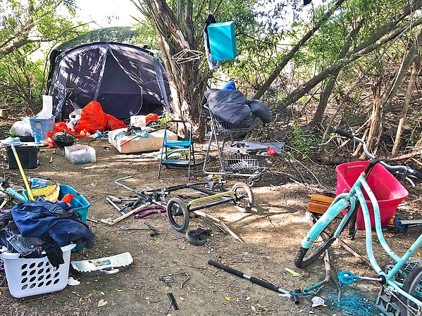 BEFORE Before the Blue Bag pilot launched in September, nearly every corner of the Higuera bridge homeless camp in SLO was overflowing with trash. - PHOTO COURTESY OF TIM WAAG