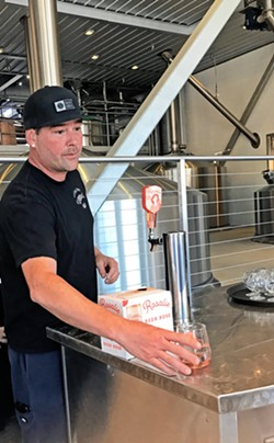 YEAR OF HYBRIDS AND SOURS Firestone Walker Brewing Company Head Brewer Dustin Kral pours Rosalie, a rosé/beer hybrid that led to one of the biggest drink trends in the nation. - FILE PHOTO BY BETH GIUFFRE