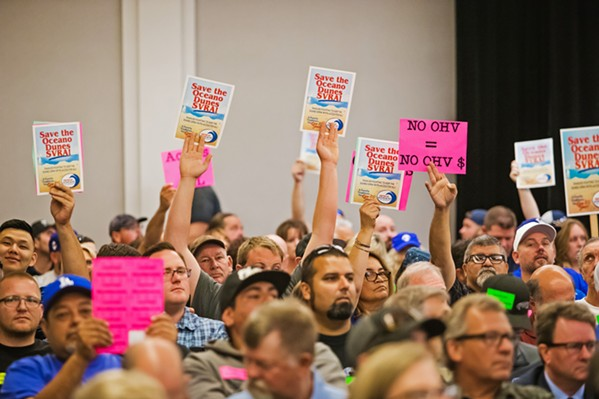 AN OLD BATTLE Hundreds of people from across the state attended a California Coastal Commission meeting in SLO on July 11, 2019, where commissioners considered a staff recommendation to limit off-highway vehicle riding in the Oceano Dunes State Vehicular Recreation Area. - FILE PHOTO BY JAYSON MELLOM