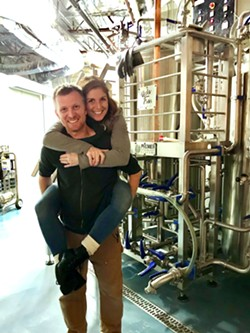 BREWERY PIGGYBACKS Brewmaster Ryan Fields gives his wife, Jacque, a piggyback ride through his brewing facility. The Fieldses have been working insane hours to bring the Atascadero community this gem of a pub, located just over the bridge from Sunken Gardens, across from the Galaxy movie theater. - PHOTOS BY BETH GIUFFRE