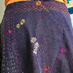 MENDED WITH FLOWERS Seamstress Rachael Hansen covered each of this skirt's many holes with hand-stitched flowers. - PHOTO COURTESY OF RACHEL HANSEN