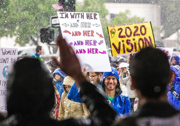 """SUPPORTING WOMEN'S RIGHTS Participants of the 2017 Women's March SLO event held signs that read, """"I'm with her."""" - FILE PHOTO BY JAYSON MELLOM"""