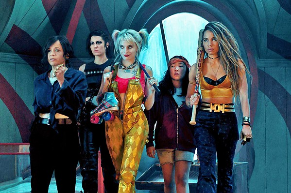 LADIES NIGHT (Left to right) Renee Montoya (Rosie Perez), Huntress (Mary Elizabeth Winstead), Harley Quinn (Margot Robbie), Cass (Ella Jay Basco), and Black Canary (Jurnee Smollett-Bell) square off against one of Gotham's arch-villains, in Birds of Prey. - PHOTO COURTESY OF DC ENTERTAINMENT