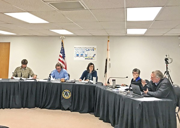 FLUMMOXED The Los Osos CSD board on Feb. 6 deliberated two more cases of extremely high water bills that were appealed to the district. - PHOTO BY PETER JOHNSON