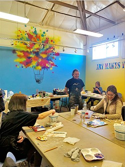 IN THE STUDIO Javier Manrique leads a group workshop at Studios on the Park on the art of fresco painting. - PHOTOS BY MALEA MARTIN