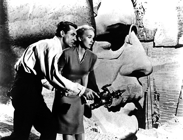 MISTAKEN IDENTITY Roger Thornhill (Cary Grant) and Eve Kendall (Eva Marie Saint) scramble around Mount Rushmore as they evade foreign agents, in Alfred Hitchcock's 1959 classic, North by Northwest, screening at Galaxy on March 1. - PHOTO COURTESY OF METRO-GOLDWYN-MAYER