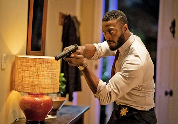 BELIEVE OR DIE Detective James Lanier (Aldis Hodge) finally realizes his childhood friend Cecilia really is being tormented by an invisible entity. - PHOTOS COURTESY OF BLUMHOUSE PRODUCTIONS