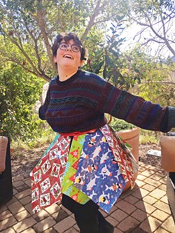"""TRASHIONISTA! Cal Poly senior Elena """"Laney"""" Richardson models her upcycled skirt made from used wrapping paper and ribbons from last Christmas. She's organizing an April 22 online Trashion Show. - PHOTOS COURTESY OF ELENA RICHARDSON"""