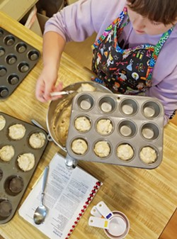 THE MUFFIN GAL I love that my younger daughter is capable of completing every step of our favorite banana muffin recipe. - PHOTOS BY ANDREA ROOKS