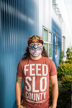 ESSENTIAL Shadoe Venezuela, 27, is a warehouse worker and driver for the SLO County Food Bank, which has seen the demand for its inventory skyrocket during COVID-19. - PHOTO BY JAYSON MELLOM