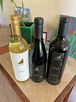 FRESH OUT THE BOX Justin Vineyard & Winery sent a three-pack to my house for a Instagram Live virtual tasting with founder winery Justin Baldwin. - PHOTO BY CAMILLIA LANHAM