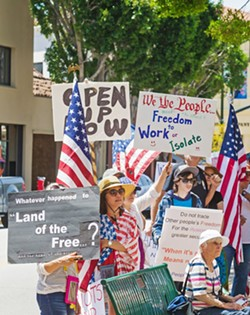 LOCAL CONTROL Protesters gather in front of the SLO County courthouse on May 8 to participate in the local ReOpen SLO County rally. - PHOTOS BY JAYSON MELLOM