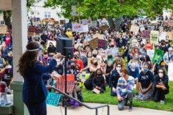 NO JUSTICE NO PEACE Hundreds of San Luis Obispo community members, wearing masks, rallied on May 31 against police violence against people of color. - PHOTO BY JAYSON MELLOM