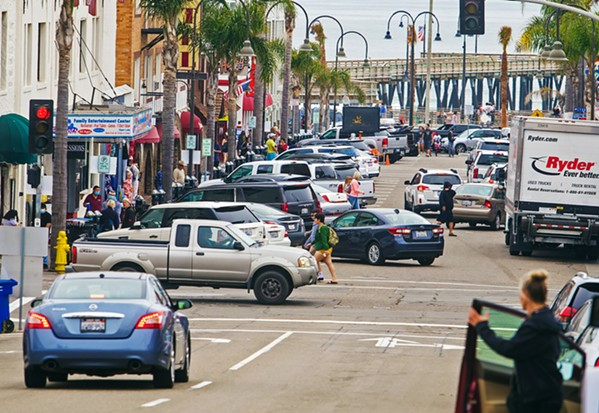 DAY TRIPPERS Despite travel and other restrictions, downtown Pismo Beach was bustling on May 29. - PHOTO BY JAYSON MELLOM
