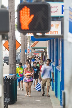 TOURIST TAX Despite coronavirus-related travel restrictions, downtown Pismo Beach was bustling on May 29. - PHOTO BY JAYSON MELLOM