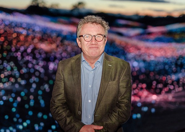 VISIONARY English/Australian artist Bruce Munro stands among his installation, Field of Light at Sensorio, in Paso Robles. - PHOTO COURTESY OF DAVID GREER
