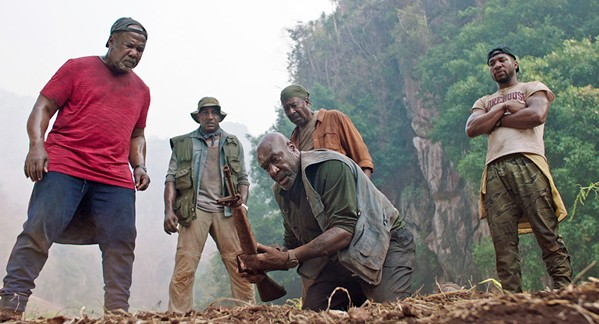 BLOOD IS THICKER Four Vietnam Vets—(left to right) Melvin (Isiah Whitlock Jr.), Eddie (Norm Lewis), Paul (Delroy Lindo), Otis (Clarke Peters)—and Paul's son, David (Jonathan Majors), go to Vietnam to repatriate the remains of the soldiers' squad leader and find buried CIA gold they hid, in Spike Lee's excellent Da 5 Bloods, screening on Netflix. - PHOTO COURTESY OF 40 ACRES & A MULE FILMWORKS