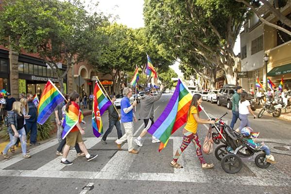 REVERSAL A group of demonstrators show their pride on Higuera Street in downtown SLO during a rally in 2017. On June 12 of this year, the U.S. Department of Health and Human Services removed nondiscrimination protections for transgender and nonbinary individuals seeking out health care and insurance coverage. - FILE PHOTO BY JAYSON MELLOM