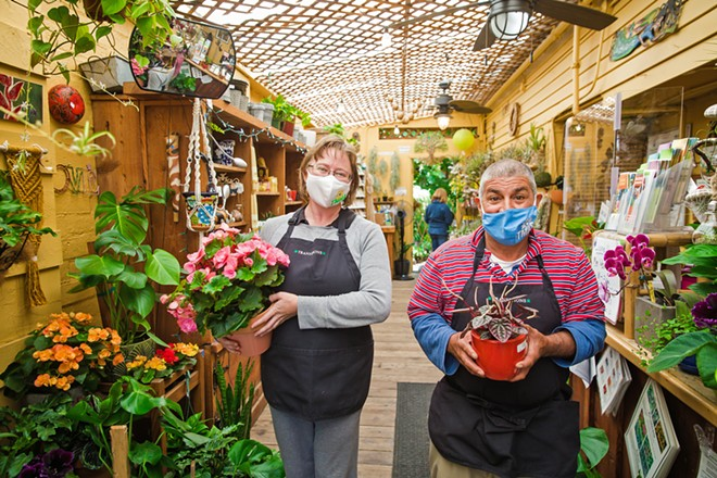 GREEN GRAIL Lela Whitter and Rene Romero hold plants at the Best Nursery/Garden Store, Growing Grounds, which has the added bonus of benefitting the Transitions-Mental Health Association. - PHOTO BY JAYSON MELLOM