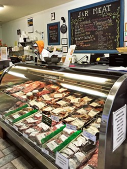 OLD SCHOOL Saunter on up to the meat counter at the J&R Natural Meat and Sausage butcher shop in Paso Robles and rewind to the old-school '50s butcher. - PHOTO BY BETH GIUFFRE