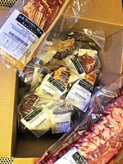 BRINGIN' HOME THE BACON Finally, I got myself a good-looking grass-fed beef box from J&R Meat and Sausage. I added on applewood smoked bacon and pork ribs. - PHOTO BY BETH GIUFFRE
