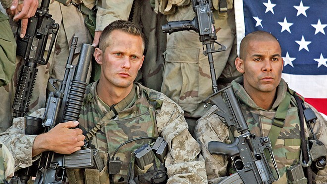 "WARRIORS Sgt. Brad ""Iceman"" Colbert (Alexander Skarsgård) and Sgt. Antonio Espera (Jon Huertas) keep the rank-and-file members of the First Recon Battalion Marines focused on their mission as they invade Iraq in 2003, in the HBO TV miniseries Generation Kill, also available on Amazon Prime."
