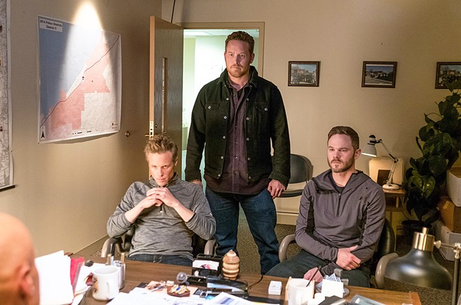 KIN After his fiancée is abducted, Roman (Ashton Holmes, left) joins her brothers Deklan (Cole Hauser, center) and Brandon (Shawn Ashmore) in finding her and dispatching her abductors, in Acts of Violence streaming on Netflix.