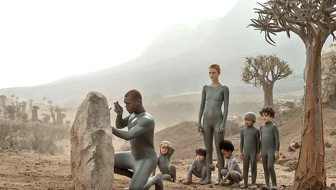 FATHER AND MOTHER Two androids, Abubakar Salim (left) and Amanda Collin (right), are tasked with saving the human race from extinction by raising human embryos on a distant planet, in Raised by Wolves on HBO Max.