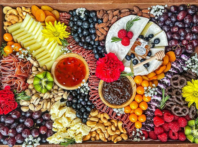 WIDE SPREAD Brie Happy Charcuterie offers a diverse range of packages to choose from, with boxes and boards in varying sizes. Customers can also customize their orders to include whichever available meat, fruit, and cheese options they prefer.