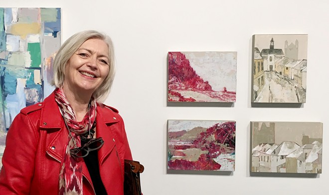 FAB FOUR Orcutt-based artist Denise Gimbel poses next to four of her recent paintings, currently featured in SLOMA's group show, Finding Spaces. On display from left to right, top to bottom: Rosy Outlook Morro Rock, Safe and Secure, Rosy Outlook Pismo Beach, and All Tucked In.