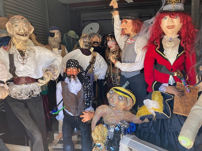 Scarecrows in storage awaiting being placed on display