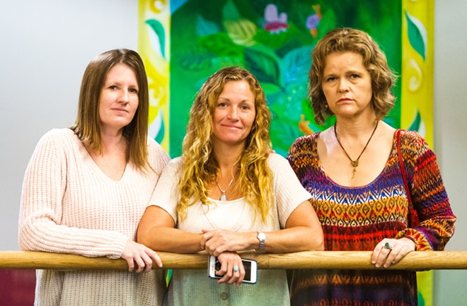 HEALING TOGETHER From left to right: Jennifer Byon, Tanya Walker, and Becky Heart attended Josiah Johnstone's hearing on Oct. 17, where they had hoped to see him sentenced to time behind bars for charges of stalking, criminal threats, and perjury. Instead, Johnstone was ordered to a mental health evaluation, and his sentencing was rescheduled for January 2020.