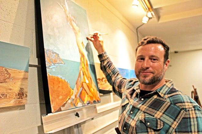 THE ARTIST AT WORK Jordan Quintero works on a new painting depicting a classic Central Coast landscape.