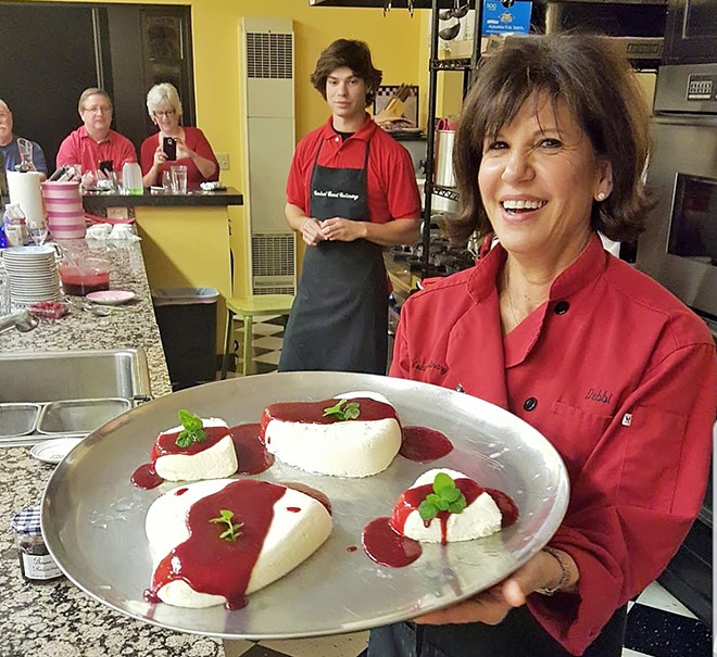 FRENCH DESSERT Every class at CCC ends sweetly, with dessert. Chef Debbie Duggan holds a tray of coeur a la creme after a recent appetizer class.