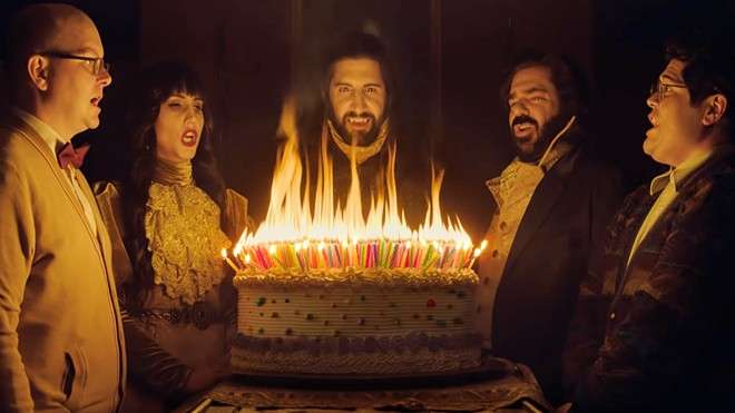 HAPPY BIRTHDAY (Left to right) Colin Robinson (Mark Proksch), Nadja (Natasia Demetriou), Nandor the Relentless (Kayvan Novak), Laszlo Cravensworth (Matt Berry), and Guillermo (Harvey Guillén), gather to celebrate Nandor's 757th birthday, in an episode of What We Do in the Shadows, a horror comedy about vampire roommates.