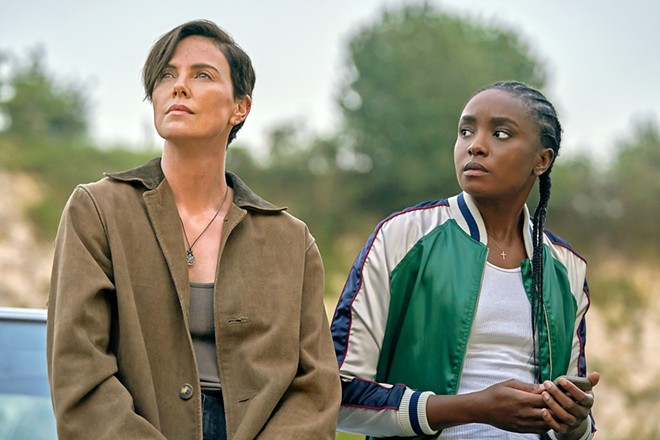 DEATH PROOF Andy (Charlize Theron), an immortal warrior, leads a group of immortals, including Nile (KiKi Layne), in the new Netflix action fantasy, The Old Guard.