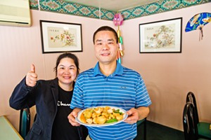 SNOW PEAS IN SHELL BEACH Mei's Chinese Restaurant owners Vicky and Yuanen Chen recommend a plate of Double Happiness from the Best Chinese Food on the coast. - PHOTO BY JAYSON MELLOM