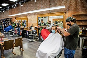 TIME FOR A CUT? Nic Cano cuts Ben Schlesier's hair at The Ritual, which doubles as a men's clothing (and other cool things) store and won Best Barber Shop. - PHOTO BY JAYSON MELLOM