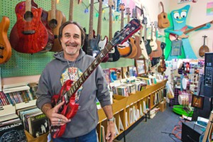 ROCK ON Central Coast Music owner Eddie Frawley takes his customers and his music personally, always on hand to chat tunes or tune up your instrument. Maybe that's why his spot is the best place to buy musicICAL INSTRUMENTS. - PHOTO BY JAYSON MELLOM