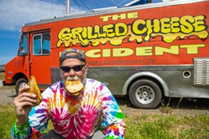 MORE CHEESE, PLEASE Grilled cheese master chef Mike McGourty puts his heart and soul into the gooey goodness he dishes out from The Grilled Cheese Incident food truck. And New Times' readers like what he's laying down. - PHOTO BY JAYSON MELLOM
