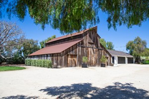 HITCH YOUR WAGON Want a barn for your wedding? A rustic setting? That old-fashioned yet modern vibe? Pretty grape vines as a backdrop? The Best Wedding Venue in the county, according to readers, is Greengate Ranch and Vineyard—and they've got all of that and more. - PHOTO BY JAYSON MELLOM