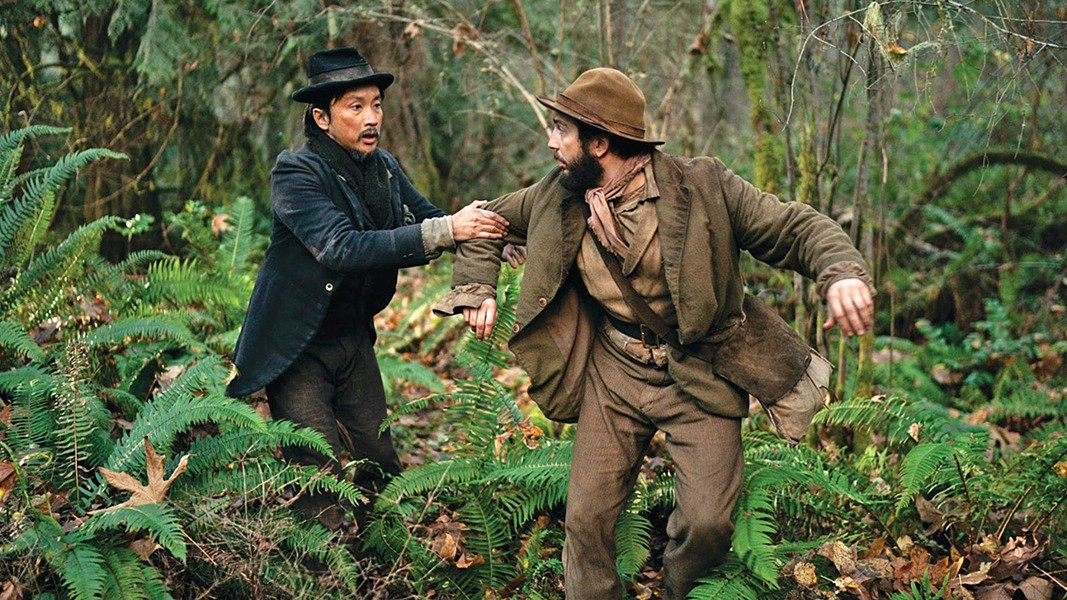 """FRIENDS IN FLIGHT Ling-Lu (Orion Lee) and Otis """"Cookie"""" Figowitz (John Magaro) forge a friendship in dangerous 1820 Oregon, as they try to make their fortune, in First Cow, available through various streaming services. - PHOTO COURTESY OF A24"""