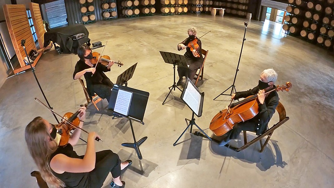 NO AUDIENCE SLO Symphony musicians (clockwise from bottom left, Emily Lanzone, Grace Seng, Karen Loewi Jones, and Barbara Hunter) record a private performance of Beethoven's String Quartet No. 4 at Cass Winery's barrel room. - PHOTO COURTESY OF THE SLO SYMPHONY