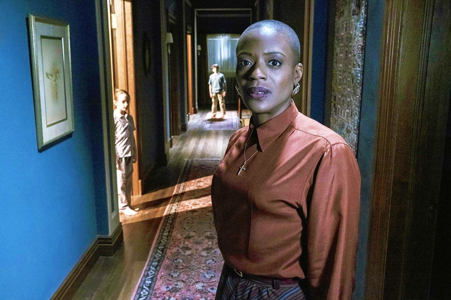 BUMP IN THE NIGHT Housekeeper Mrs. Grose (T'Nia Miller, foreground) and the Wingrave orphans—Flora (Amelie Bea Smith) and Miles (Benjamin Evan Ainsworth)—share their house with strange apparitions, in the Netflix miniseries The Haunting of Bly Manor. - PHOTO COURTESY OF AMBLIN TELEVISION