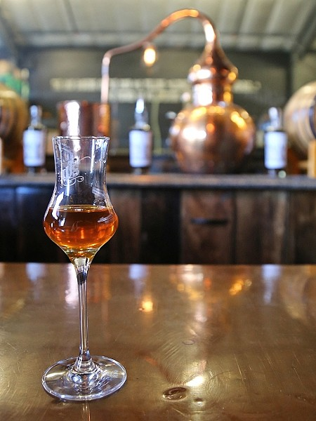 NOT YOUR MOM'S JUICE :  Paso Robles area grapes have graduated to the next level of liquor at places like Wine Shine, which distills brandy from the fruit that makes the area famous. - PHOTO BY DYLAN HONEA-BAUMANN