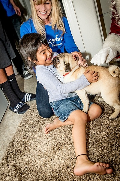 HOPE, STRENGTH, JOY:  Little Paige receives her wish of a new dog. Make-A-Wish Foundation of the Tri-Counties grants wishes for children who are battling life-threatening illnesses. Make-A-Wish grants 20 wishes every year in SLO County and is in need of donations from the public. - PHOTO COURTESY OF MAKE-A-WISH FOUNDATION OF THE TRI-COUNTIES