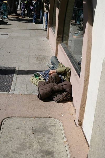 THIS LOOKS LIKE A GOOD PLACE TO SLEEP:  OK, technically this could just be a homeless guy, but I couldn't find any passed-out drunk kids. - PHOTO BY GLEN STARKEY