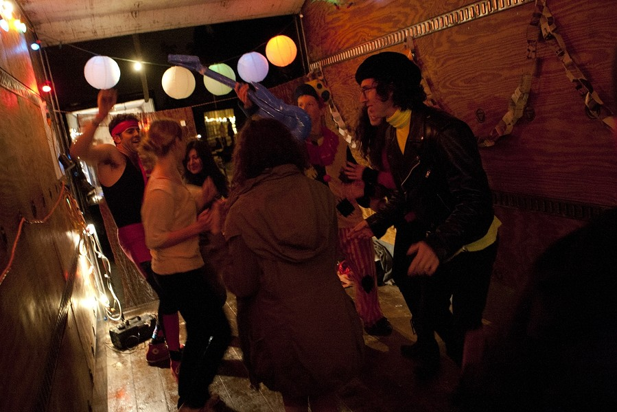 DANCE! :  A small but enthusiastic throng of revelers gets its groove on in KCPR's dance party truck. - PHOTO BY STEVE E. MILLER