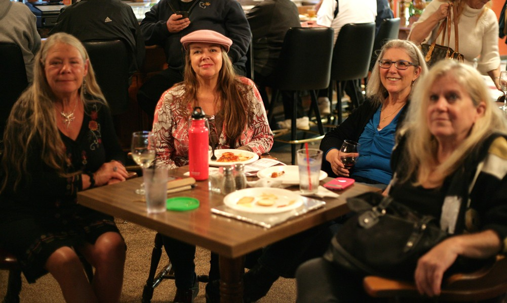 """OSCAR LADIES!:  A quartet of film fans—(left to right) Nancy Craig, Karter Hischke, Connie """"Blues Chick"""" Booton, and Bonnie Trahan—braved the noisy Elks Lodge bar to soak in Hollywood's glitterati. - PHOTO BY GLEN STARKEY"""